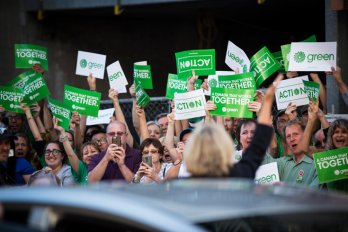 Green party Leader Elizabeth May waves to her supporters