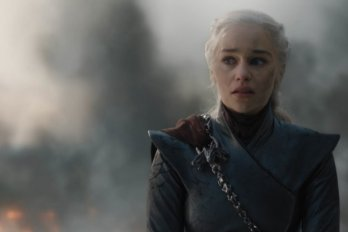 Daenerys from Game of Thrones stands in front of a smoke-filled background.
