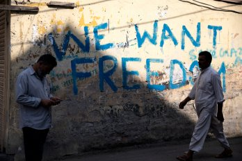 "Graffiti on the wall in Srinagar reading ""We want freedom."""