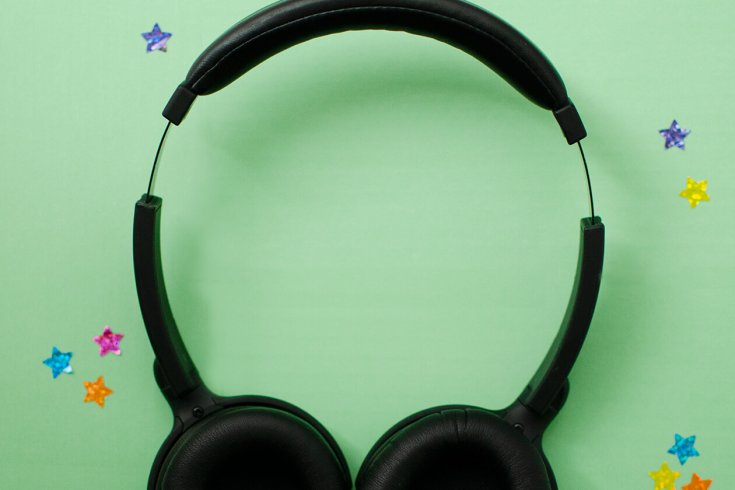 Pair of headphones on a green backdrop