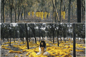 several people walking in a park wearing yellow