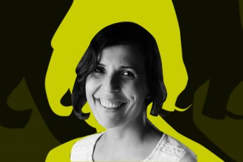 A photo of the poet, who is smiling at the camera and has short, dark hair. Behind her is a lime-green and black background.