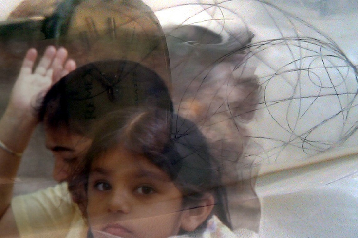 A layered photo of the artist and her mother as a child, against a translucent background.