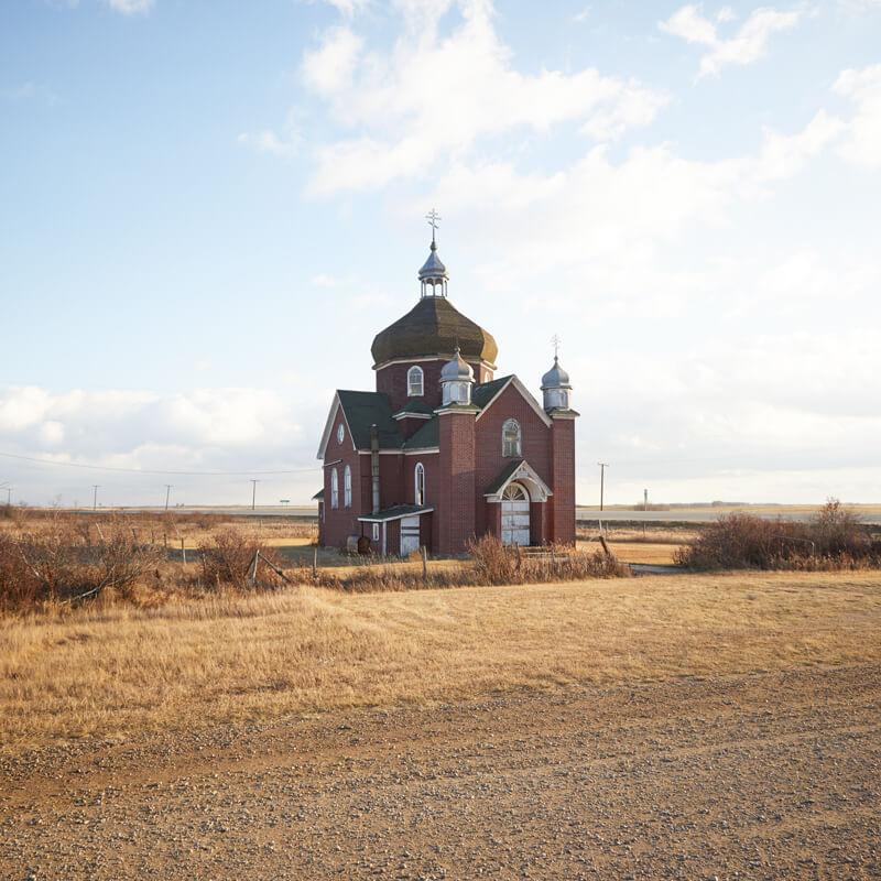Brick church in field