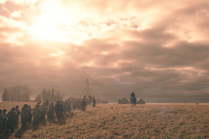 """Still from the TV Show """"The Handmaid's Tale"""" showing group of women walking in radioactive field"""