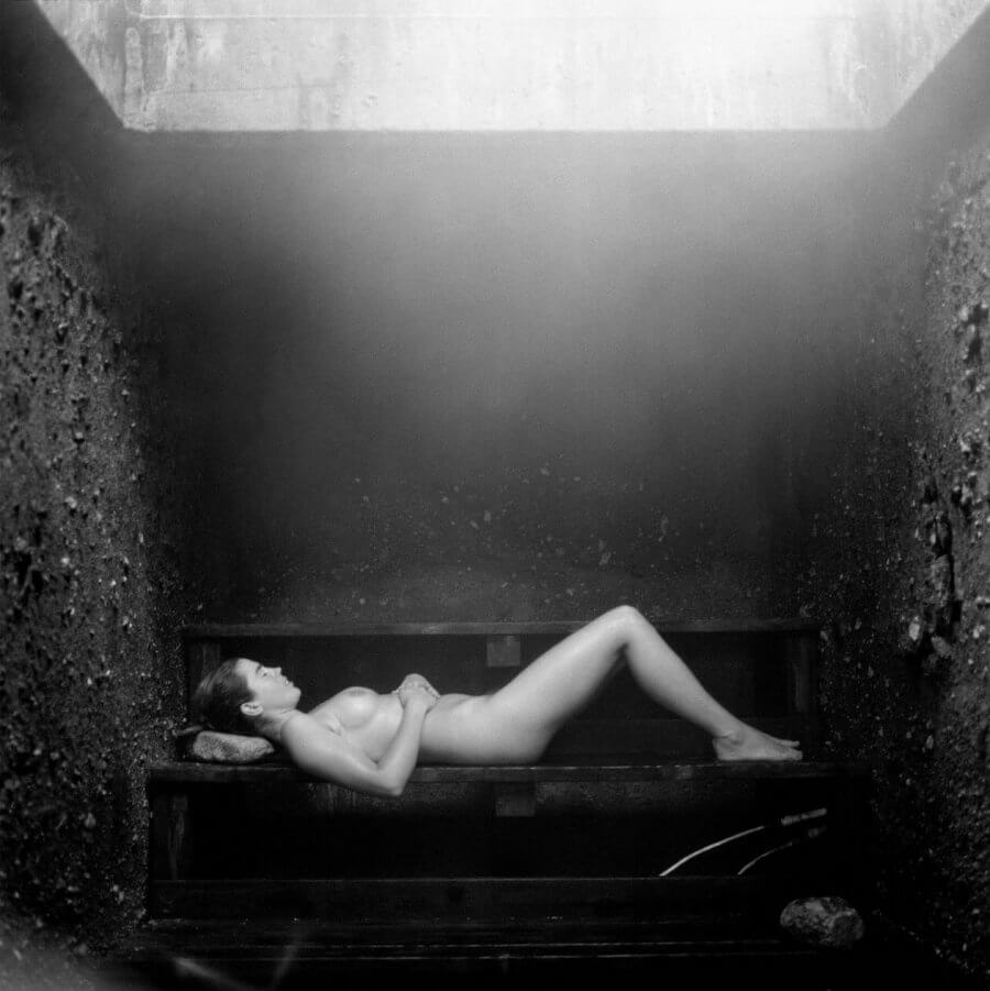 Woman lying down in steam room