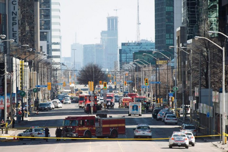 First responders close down Yonge Street in Toronto after a van mounted a sidewalk, crashing into a number of pedestrians on April 23, 2018