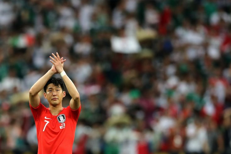 Son Heung-Min waves to a crowd during a world cup game