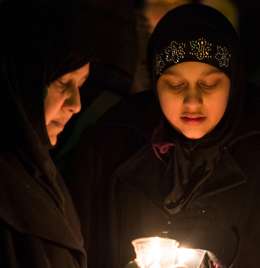 Picture of two women at a vigil for the victims of Quebec City mosque shooting