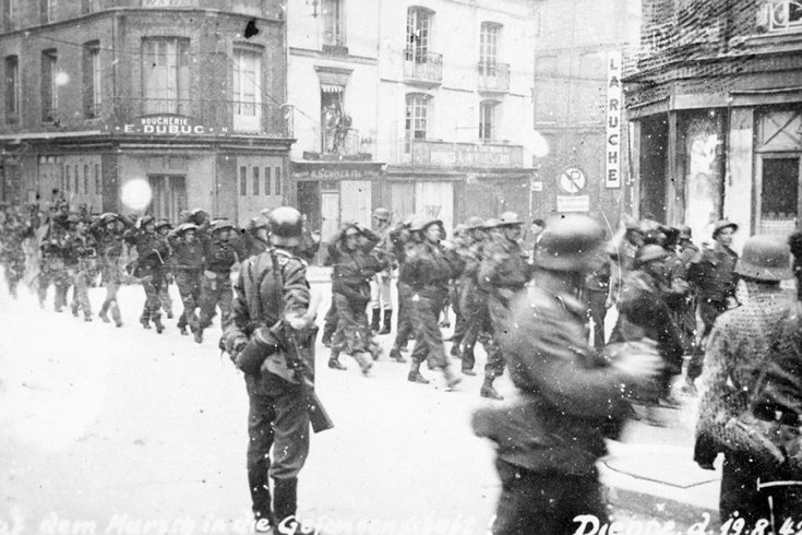 Captured Canadian troops are marched through the streets of Dieppe, following Operation Jubilee