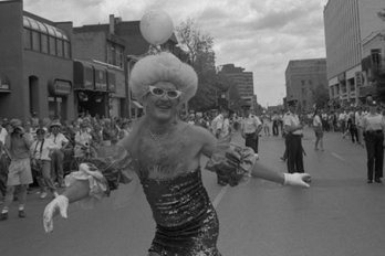 Man in the middle of the street during a parade