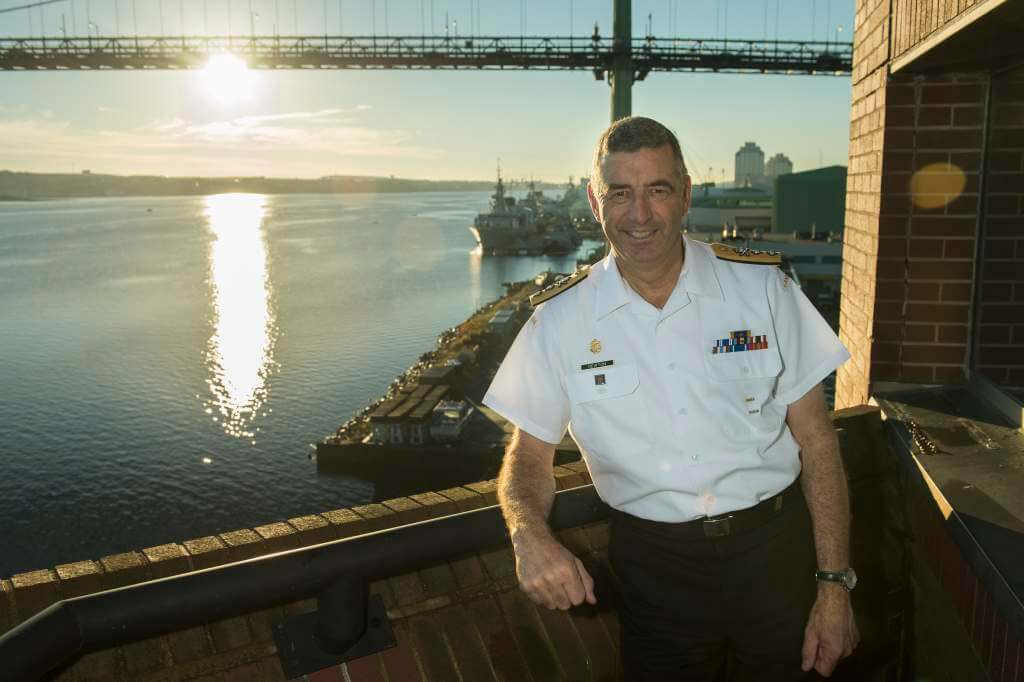Commander Maritime Forces Atlantic (MARLANT), Rear Admiral John Newton, poses for an environmental portrait on the 6th floor balcony of MARLANT Headquarters on October 2, 2013. Image by: Cpl Charles A. Stephen, Formation Imaging Services HS2013-1123-001