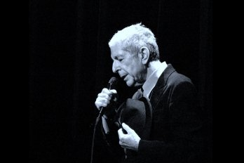 Black and white photo of Leonard Cohen.