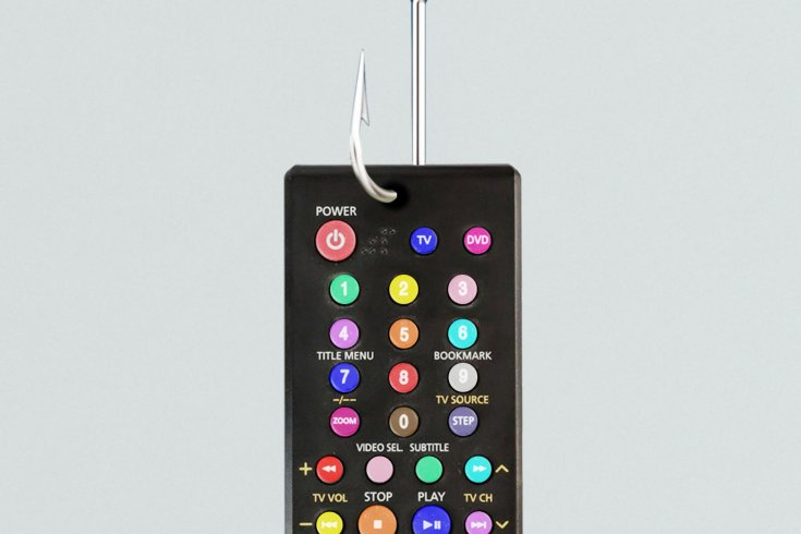 A TV remote control with rainbow buttons.