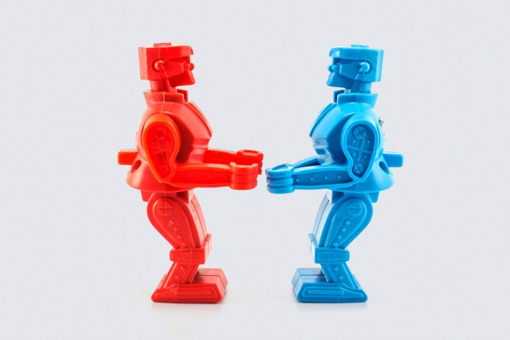 blue and red toy robots facing each other