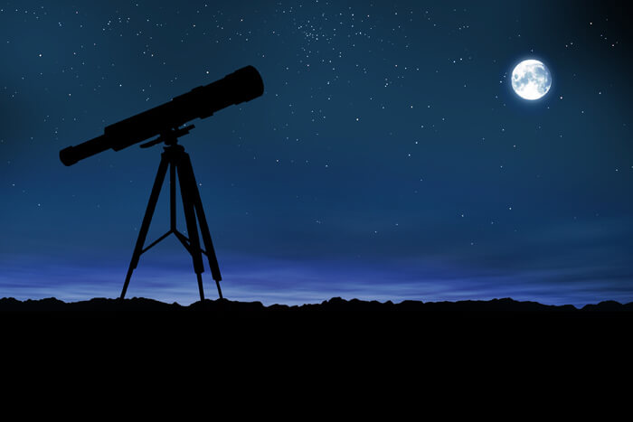 telescope and night sky with moon