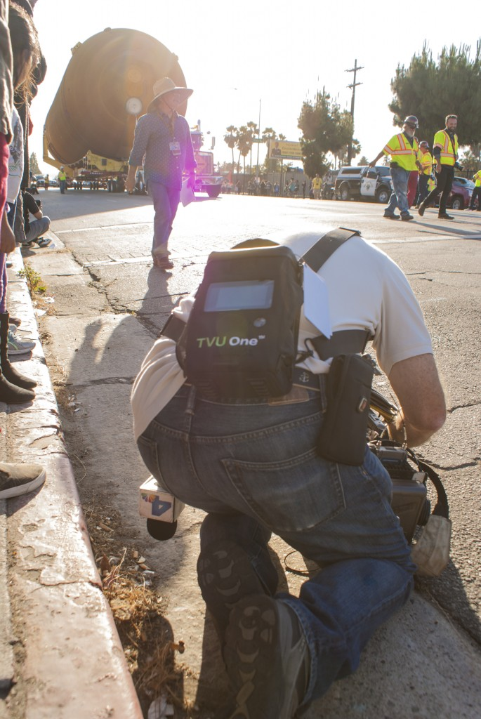 An NBC 4 cameraman gets a low angle of ET-94 and its towing rig as it prepares to turn onto Bill Robertson Lane from King Boulevard. (Maisa Zocco / USC Annenberg Media)