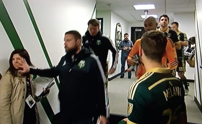 What Is This Timbers Dude Doing to This Woman's Face?
