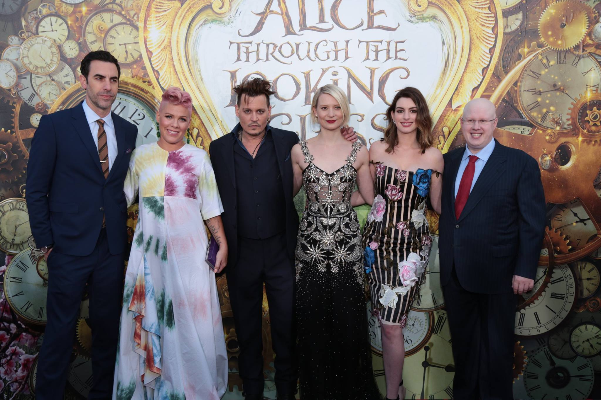 "Sacha Baron Cohen, Pink, Johnny Depp, Mia Wasikowska, Anne Hathaway and Matt Lucas pose together at The US Premiere of Disney's ""Alice Through the Looking Glass"" at the El Capitan Theater in Los Angeles - photo from Disney"