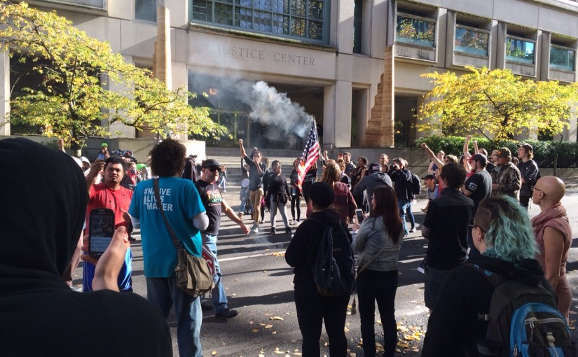Black Lives Matter Protesters Burn Bundy Supporter's American Flag in Front of Portland Justice Center
