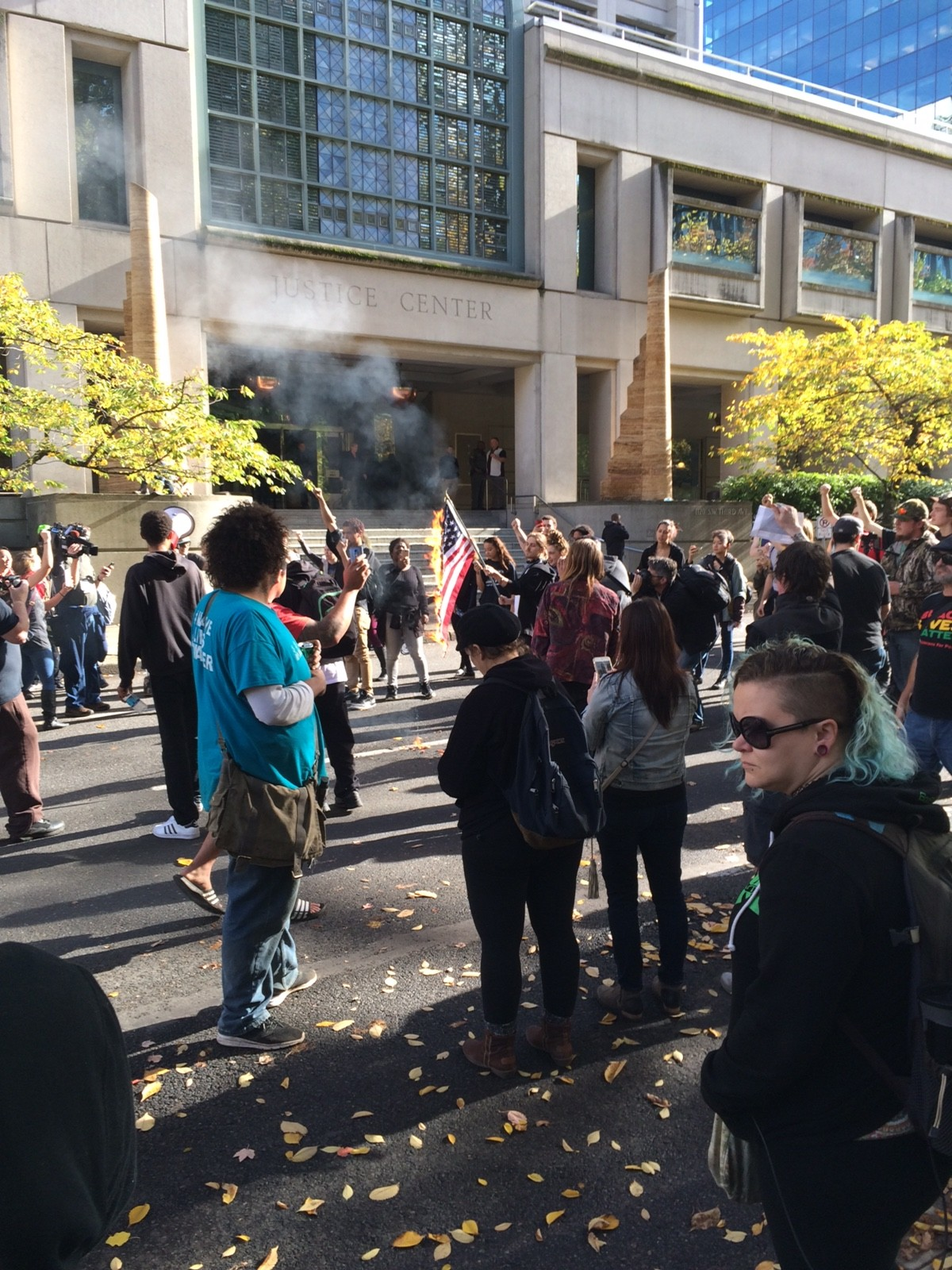 Don't Shoot Portland protesters burn an American flag on Oct. 29, 2016. (Nigel Jaquiss)