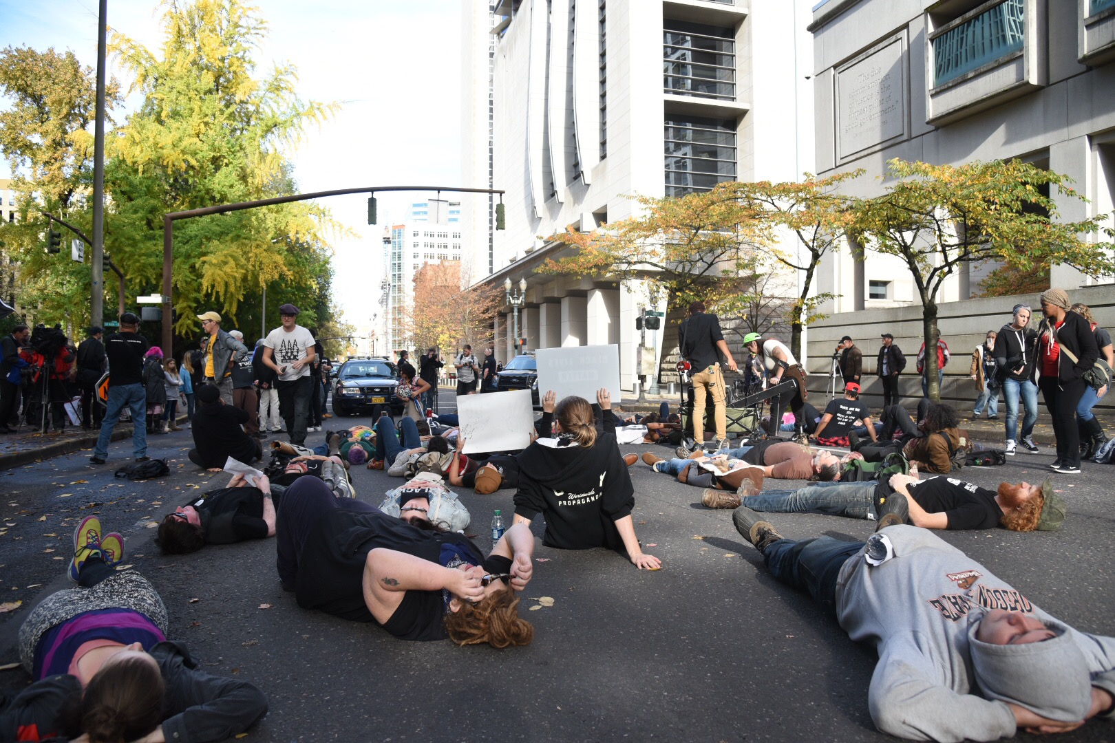 """Black Lives Matter protesters stage a """"die-in"""" on Southwest 3rd Avenue on Oct. 29, 2016. (Joe Riedl)"""