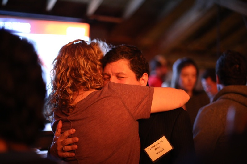 Steve Novick gets a consoling hug on election night. (Maya Setton)