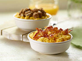 Breakfast bowls, bacon and sausage shown