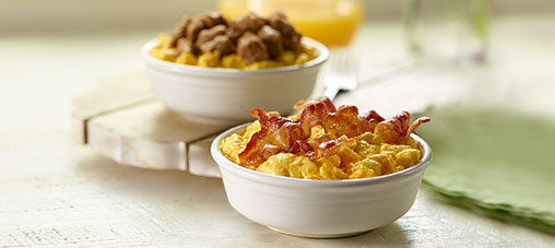 Breakfast bowl varieties - scrambled eggs with with various breakfast meats like sausage and bacon