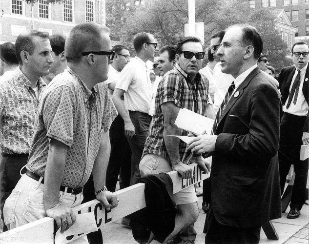 Frank Kameny talks with bystanders at the 1966 Annual Reminder. Photograph by Kay Tobin Lahusen. Barbara Gittings and Kay Tobin Lahusen Collection, John J. Wilcox, Jr. Archives
