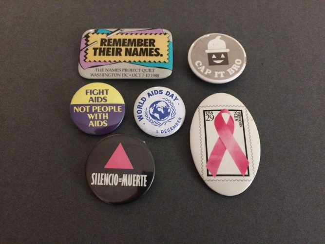 Buttons from the early years of the AIDS epidemic. John J. Wilcox, Jr. Archives.
