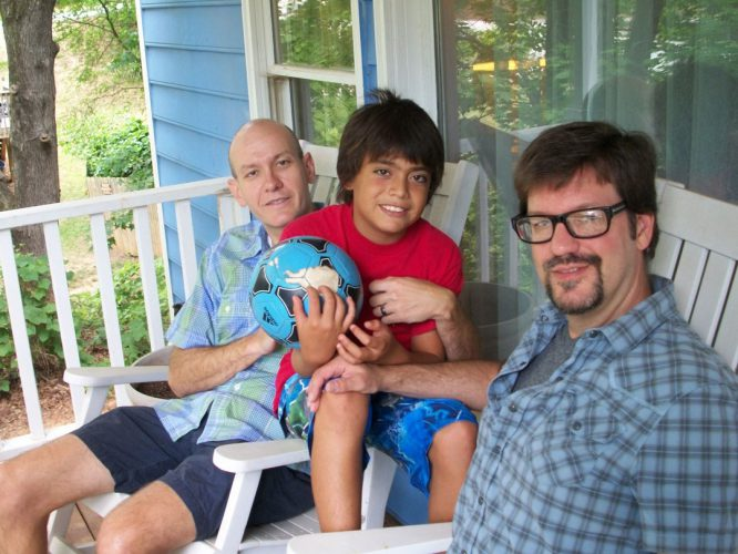 Shawn Long, Craig Johnson and son, Isaiah. American Civil Liberties Union, 2013