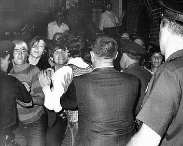 Photograph from the front page of the New YorkDaily Newstaken outside the Stonewall Inn on Sunday, June 29, 1969
