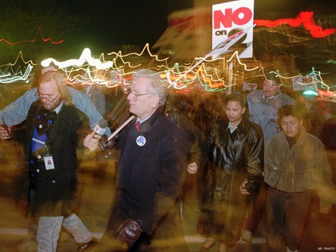 Former Colorado Gov. Roy Romer marches with LGBT people protesting the passage of Amendment 2 in 1992. Photograph by AP.