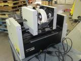 A photo of Accufast KT2 double headed tabber with Accufast FX Feeder