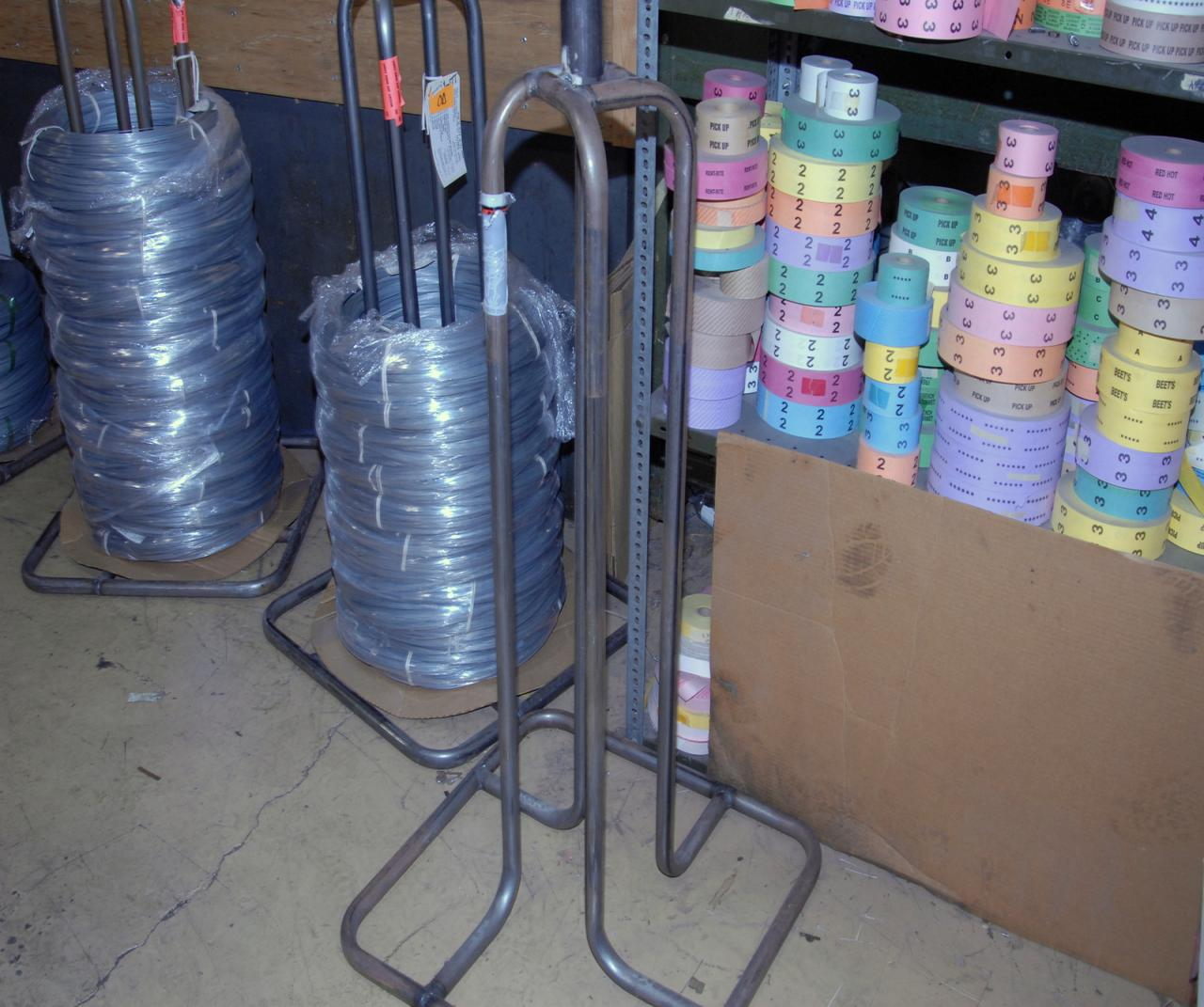 Steel Coil Stands : Lot of steel coil supplies and four stands