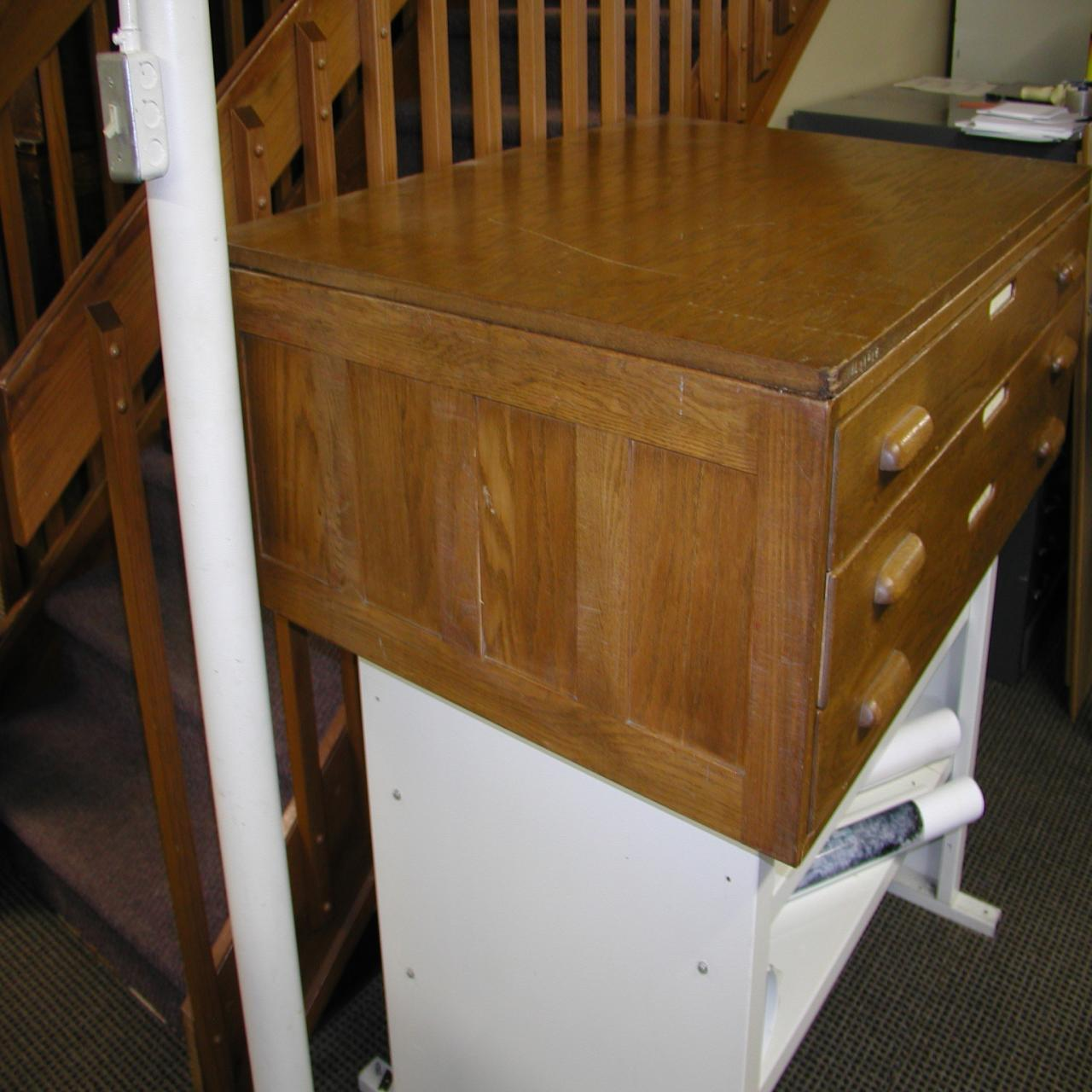 Lot #20: ANTIQUE WOODEN FLAT FILE CABINET - WireBids