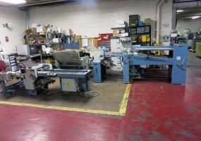 a photo of 1996 MBO T49 Continuous Feed 4/4/4 Paper Folder w/ 8 Page, 16 page, and Roll Away Delivery