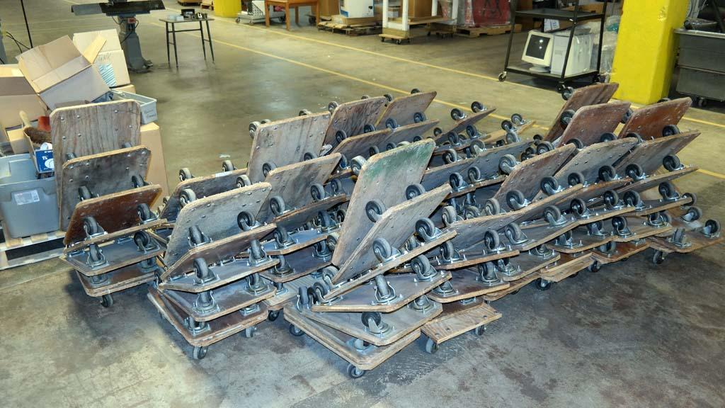 Lot 69 approximately 100 rolling floor dollies 14 x for 100 floors floor 69