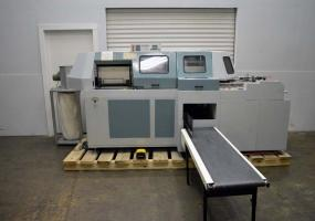 a photo of 1998 Duplo Quadrimax Programmable Four Clamp Perfect Binder w/ Cover Feeder & Delivery