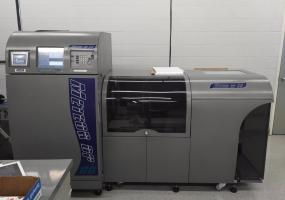 a photo of 2009 Meteor DP60 Pro 4 Color Digital Press with Spare Parts, High Pile Stacker, Pro Feeding System - Burlington, Ontario, Canada