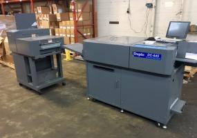 a photo of 2006 Duplo Model DC-645 Slit/Cut/Crease with Integrated Folding System - Grand Rapids, MI - Click for Video! - NEW PHOTOS -
