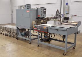 a photo of 2001 Shanklin S-26 Semi-Automatic Shrink Wrap System