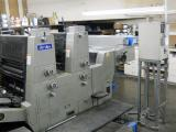 a photo of 1987 Akiyama Hi-Ace 228 2 Color Press with AKI II Dampening, Royse Alcomizer Recirculator, IR Dryer, Sprayer DE Curler, Continuous Feed and Delivery - Los Angeles, CA