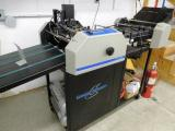 a photo of Graphic Whizard 12000 Numbering Perforating Scoring & Slitting Machine - Grand Rapids, MI - Click for Video!