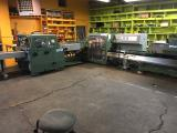 a photo of Reconditioned 1998 Muller Bravo-T - Six 1555 Feeders,1529 Cover Feeder, 380 Stitching Unit w/ Two Hohner M-50 Stitcher Heads, 360 Three Knife Trimmer, Model 1511 Belt Delivery, 2 Rietschle CLFG-80 Vacuum Pumps, Extra Parts & Knives - Hampshire, IL