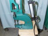 a photo of United Shoe Machinery Corp  Model 261 Eyeleter 192 with Wood Stand and 35lbs of Eyelets - Cleveland, OH