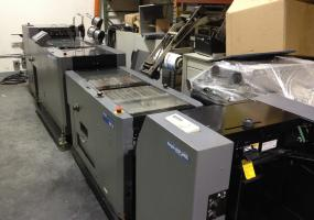 a photo of Duplo 5000 Bookletmaker with DFS-2000 Sheet Feeder and Slitter / Cutter / Creaser / Trimmer with Computer and Software - Chicago, IL