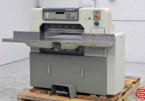 a photo of 1987 Polar 76 SD-P Paper Cutter with Power Back Gauge / Positioner and Air Table - Click for Video!