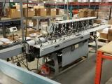 a photo of HM Surchin Company Six Station Turn Over Open Feed Station Conveyor #1 - Kennesaw, GA - Click for Video!